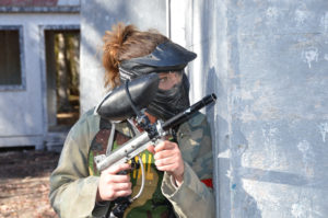 Female paintball player playing paintball at Skirmish paintball in Jim Thorpe, PA