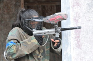 Lady playing paintball at Skirmish Paintball